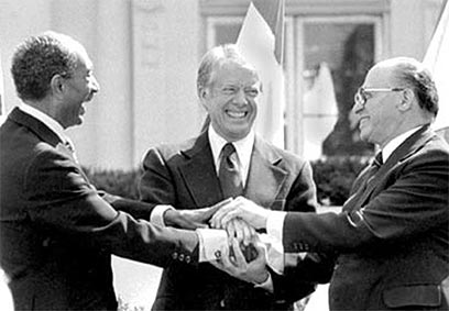 This famous image of President Jimmy Carter and Israeli and Egyptian leaders at the Camp David Accords gives hope for peace in the Middle East